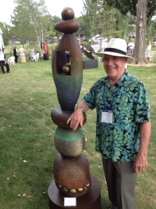 Warren at Loveland Sculpture Show with bronze sculpture Spirit Totem.