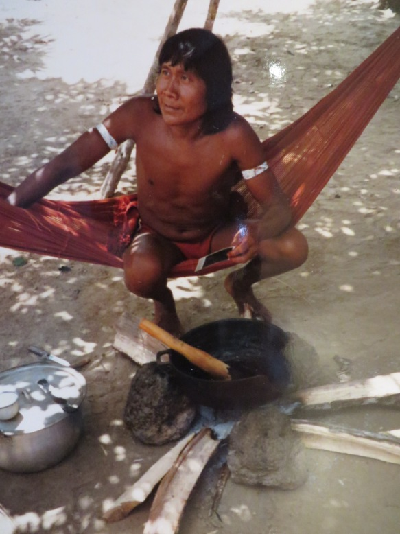 A tribesman in Amazonia cooking curare, the poison used on blowguns.